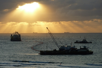 sunset, you get a view of three boats laying cable on the seabed