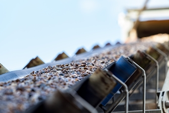 a view of gravel being carried on the mining conveyor belts